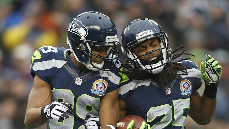 Seattle Seahawks cornerback Richard Sherman (25) celebrates with wide receiver Doug Baldwin (89) after returning an interception from Arizona Cardinals quarterback John Skelton for a 19-yard touchdown during the second quarter of an NFL football game in Seattle, Sunday, Dec. 9, 2012. (AP Photo/John Froschauer)
