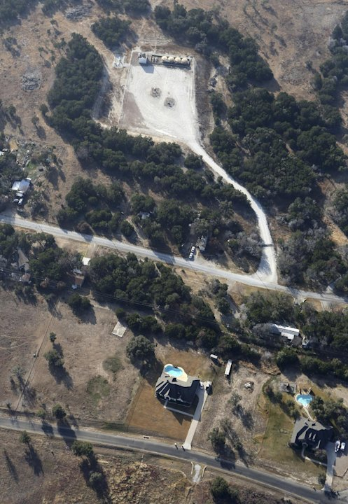 This Dec. 6, 2012 aerial photo shows a natural gas well, top, in rural Parker County near Granbury, Texas. The U.S. Environmental Protection Agency had evidence the gas company's drilling operation co