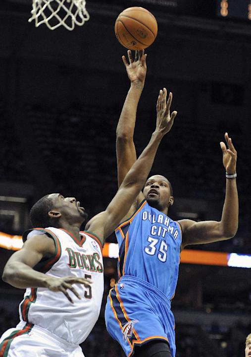 Milwaukee Bucks' Ekpe Udoh (5) defends as Oklahoma City Thunder's Kevin Durant (35) shoots during the first half of an NBA basketball game Saturday, Nov. 16, 2013, in Milwaukee