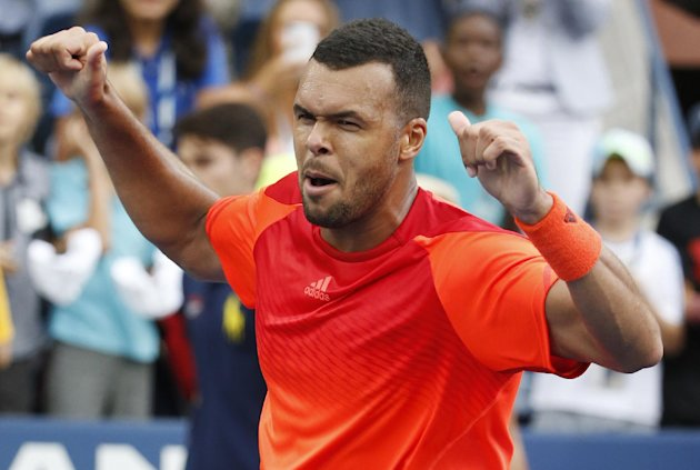 Jo-Wilifried Tsonga, of France, reacts after defeating Pablo Carreno Busta, of Spain, during the third round of the U.S. Open. (AP Photo/Kathy Willens...