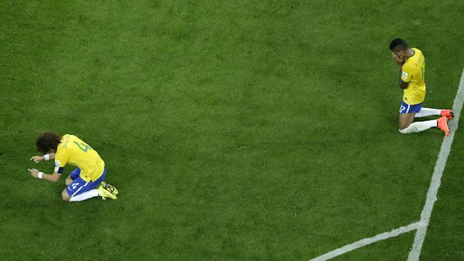Brazil's David Luiz, left and Luiz Gustavo react after the World Cup semifinal soccer match between Brazil and Germany at the Mineirao Stadium in Belo Horizonte, Brazil, Tuesday, July 8, 2014. Germany has routed host Brazil 7-1 and advanced to the final of the World Cup. (AP Photo/Felipe Dana, Pool)