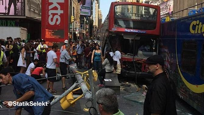Double-decker buses crash in Times square; 14 hurt