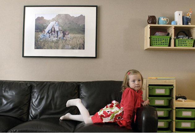 Coy Mathis sits on a couch at her home in Fountain, Colo., Monday Feb. 25, 2013. Coy has been diagnosed with Gender Identity Disorder. Biologically, Coy, 6, is a boy, but to his parents, three sisters