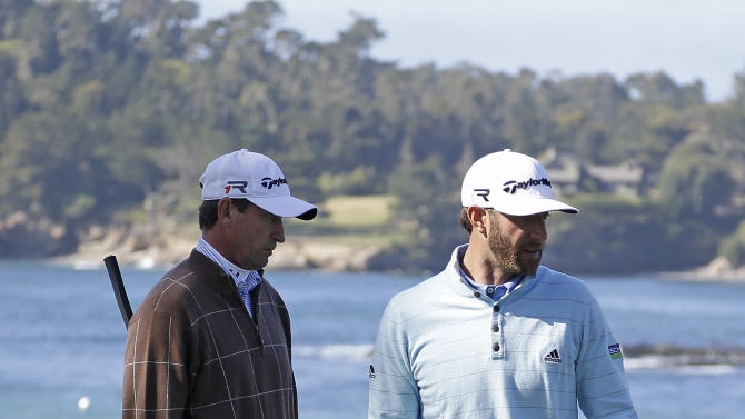 Dustin Johnson, right, and Wayne Gretzky, left, read the fifth green of the Pebble Beach Golf Links during the third round of the AT&T Pebble Beach Pro-Am golf tournament Saturday, Feb. 9, 2013, in Pebble Beach, Calif. (AP Photo/Eric Risberg)