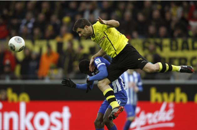 Borussia Dortmund's Sokratis and Hertha Berlin's Ramos jump for a ball during the German first division Bundesliga soccer match in Dortmund