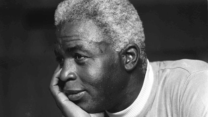 """FILE - In this June 30, 1971 file photo,  Jackie Robinson poses at his home in Stamford, Conn. Kansas City's Negro Leagues Baseball Museum is hosting an advance screening of an upcoming movie about Robinson, who broke major league baseball's color barrier. Thomas Butch of the financial firm Waddell and Reed announced Wednesday, March 20, 2013 that actors Harrison Ford and Andre Holland will be among those appearing at an April 11 screening of """"42.""""   (AP Photo/File)"""