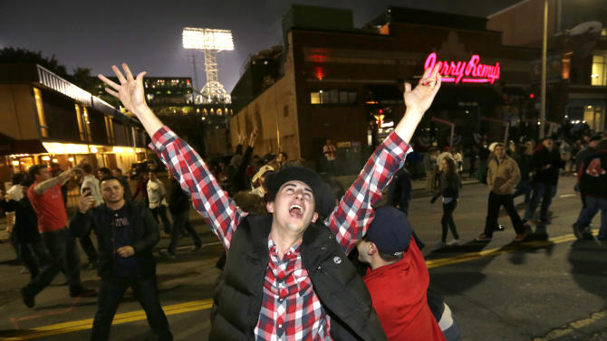 Boston Red Sox fans celebrate in the street near Fenway Park following Game 6 of baseball's World Series between the Red Sox and the St. Louis Cardinals, Wednesday, Oct. 30, 2013, in Boston. The Red Sox won 6-1 to win the series. (AP Photo/Steven Senne)