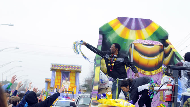 IMAGE DISTRIBUTED FOR FOX SEARCHLIGHT - Dwight Henry, star of the Academy Award nominated film Beasts of the Southern Wild, throws beads in the Argus parade on Mardi Gras on Tuesday, Feb. 12, 2013 in Metairie, La. (Photo by Cheryl Gerber/Invision for Fox Searchlight Pictures/AP Images)