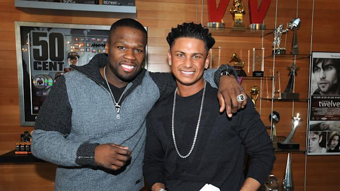 """Rapper and businessman Curtis Jackson, also known as 50 Cent, poses with Paul """"DJ Pauly D"""" DelVecchio from MTV's """"Jersey Shore,"""" at the G-Unit Offices, Thursday, Dec. 1, 2011 in New York. DelVecchio signed a record deal with 50 Cent's G-Note record label, which focuses on dance and pop music. (AP Photo/PictureGroup, Brad Barket)"""