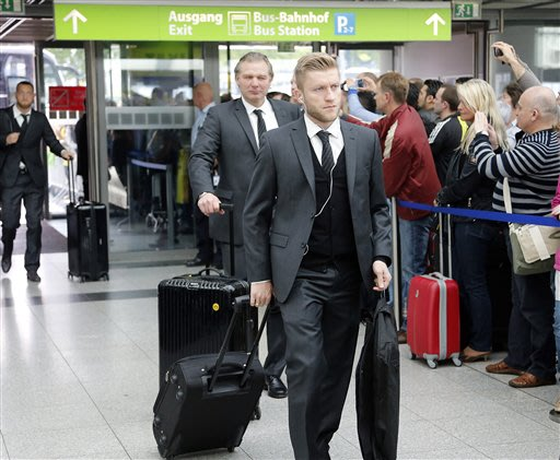 Dortmund's Jakub Blaszczykowski of Poland arrives at the airport in Dortmund, Germany, Friday, May 24, 2013. The soccer team of Dortmund is on it's way to London for the Champions League Final between