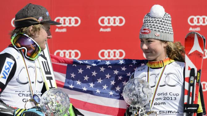 Ted Ligety of the US, left, holds the crystal globe as the winner of the men's overall giant slalom World Cup and Mikaela Shiffrin of the US, right, holds the crystal globe as the winner of the women's overall slalom  World Cup at the Alpine Ski World Cup finals, in Parpan - Lenzerheide, Switzerland, Saturday, March 16, 2013. (AP Photo/Keystone, Laurent Gillieron)