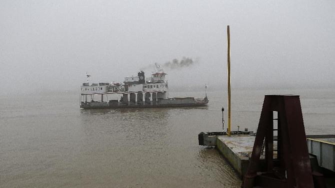 This Jan. 15, 2013 photo shows a ferry boat crosses the Mississippi River from Downtown to Algiers in New Orleans. Super Bowl takes place in New Orleans on Feb. 3 and Mardi Gras falls nine days later on Feb. 12. With both events so close together, New Orleans is bracing for a massive celebration and record crowds.  (AP Photo/Gerald Herbert)