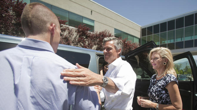 Republican presidential candidate, former Utah Gov. Jon Huntsman, center, hugs his son Will Huntsman, left, as he finishes touring Nelson Laboratories with his wife Mary Kaye Huntsman, right, in Taylorsville, Utah, Tuesday June 28, 2011. Huntsman toured the lab and meet the staff during a campaign stop in Utah. (AP Photo/Jim Urquhart)