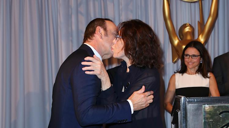 "Lily Tomlin, right, congratulates Kevin Spacey after being nominated for outstanding lead actor in a drama series for ""House of Cards"" at the Television Academy's 66th Emmy Awards Performers Peer Group Celebration at the Montage Beverly Hills on Monday, July 28, 2014, in Beverly Hills, Calif. (Photo by Matt Sayles/Invision for the Television Academy/AP Images)"