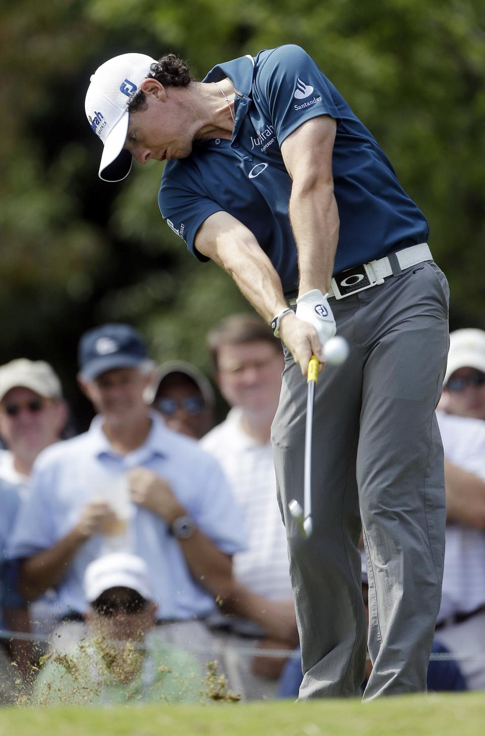 Rory McIlroy, of Northern Ireland, tees off on the second hole during the first round of the Tour Championship golf tournament in Atlanta on Thursday, Sept. 20, 2012.  (AP Photo/John Bazemore)