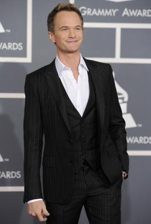 """FILE - In a Feb. 12, 2012 file photo, Neil Patrick Harris arrives at the 54th annual Grammy Awards in Los Angeles. Producers of the Tony Awards show announced Tuesday, April 3, 2012 that Harris, the star of the sitcom """"How I Met Your Mother"""" and a stage veteran, will be back for his third turn hosting the Tony Awards on June 10. (AP Photo/Chris Pizzello, File)"""