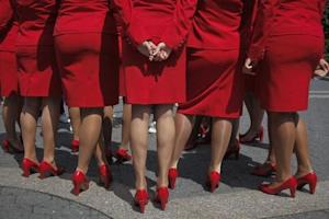 Crew members of Virgin Atlantic Airways stand together in Union Square during a promotional event by the British owned airline to celebrate the Diamond Jubilee of Queen Elizabeth in New York