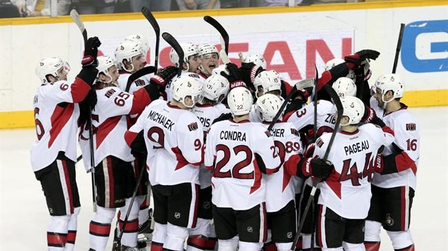 Ottawa Senators players celebrate after beating the Nashville Predators in an NHL hockey game Saturday, Jan. 11, 2014, in Nashville, Tenn. The Senators won 2-1 in a shootout. (AP Photo/Mark Humphrey)
