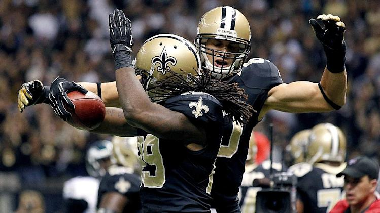New Orleans Saints tight end Jimmy Graham (80) celebrates with running back Chris Ivory (29) after Ivory's touchdown during the first half of an NFL football game at Mercedes-Benz Superdome in New Orleans, Monday, Nov. 5, 2012. (AP Photo/Bill Haber)