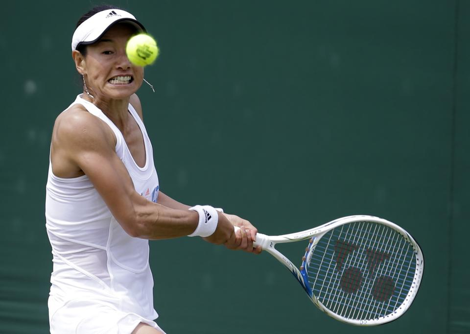 Kimiko Date-Krumm of Japan returns to Alexandra Cadantu of Romania during their Women's second round singles match at the All England Lawn Tennis Championships in Wimbledon, London, Thursday, June 27, 2013. (AP Photo/Anja Niedringhaus)