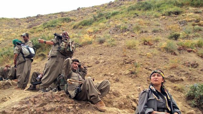 This photo taken on Tuesday May 7, 2013 and provided by Firat News Agency on Wednesday May 8, 2013 shows rebels of the Kurdistan Workers Party, or PKK, in Turkey close to the border with Iraq. A Kurdish party leader said Wednesday rebels have started to move out of Turkey to bases in northern Iraq, a key stage in the peace process with the Turkish government. The PKK declared a cease-fire in March and agreed to a gradual retreat from Turkish territory as part of peace efforts aimed at ending a nearly three-decade-old conflict that has killed tens of thousands of people. (AP Photo/Firat News Agency) TURKEY OUT