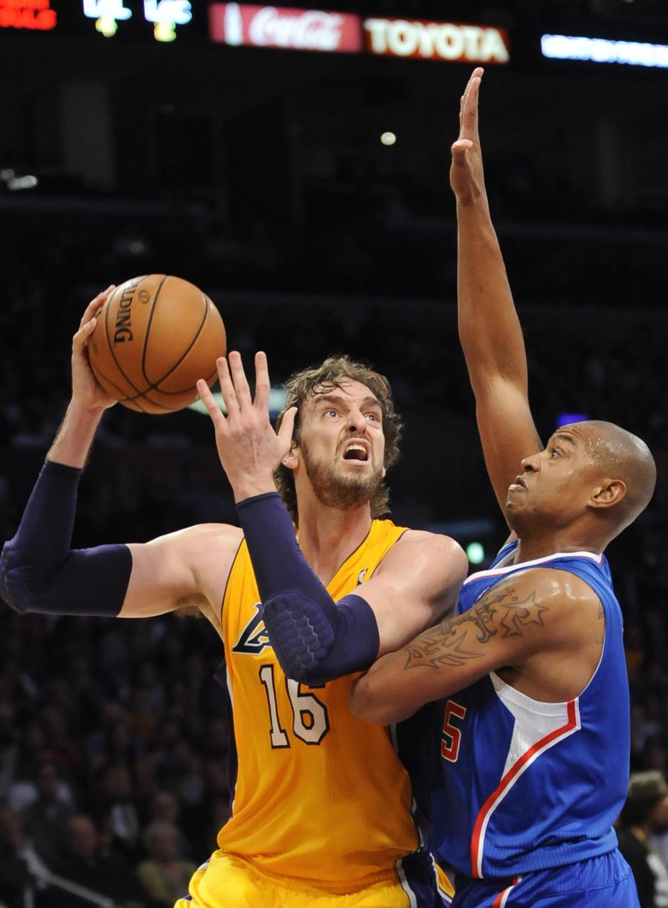 Los Angeles Lakers forward Pau Gasol (16), of Spain, drives on Los Angeles Clippers forward Caron Butler (5) as he goes to the basket in the first half of an NBA basketball game, Friday, Nov. 2, 2012, in Los Angeles.(AP Photo/Gus Ruelas)
