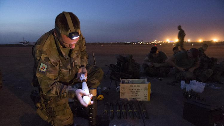 "In this picture dated Sunday, Jan. 13, 2013 and released by the French Army Communications Audiovisual office (ECPAD), a French soldier of the 2nd Marine Infantry Regiment based in Le Mans, western France, prepares ammunition before distribution at Bamako airport, Mali. An official at France's Defense Ministry says the country will ""gradually deploy"" a total of 2,500 troops to Mali, and the French president says the military operation will last until security has been restored and African forces are ready to take charge. (AP Photo/Arnaud Roine, ECPAD)"