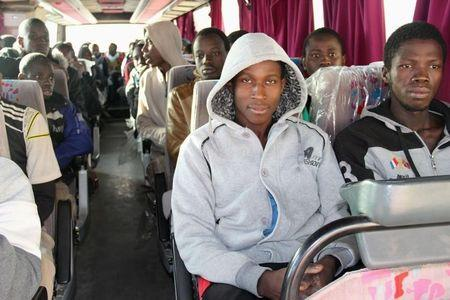 A group of Senegalese illegal immigrants sit in a bus at the Alkarareem immigration centre in the east of Misrata
