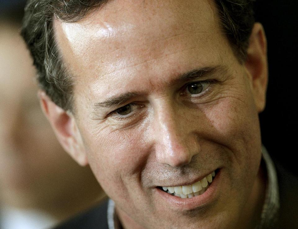 Republican presidential candidate, former Pennsylvania Sen. Rick Santorum talks to supporters during a rally Monday, March 19, 2012, in Moline, Ill. (AP Photo/Charlie Riedel)