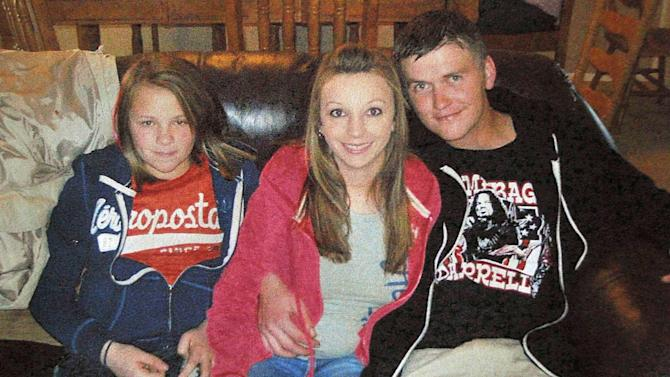 FILE - This Dec. 25, 2010 file photo provided by Clint Dunn shows his 13-year-old daughter, Hailey Dunn, left, poses for a photo with her mother Billie Jean Dunn, center, and her mother's boyfriend Shawn Adkins on Christmas day in Colorado City, Texas. Authorities in West Texas on Friday, April 26, 2013, confirmed the remains found in a remote part of Scurry County in March are those of Hailey Dunn, who has been missing since December 2010.  (AP Photo/Courtesy of Clint Dunn, File)