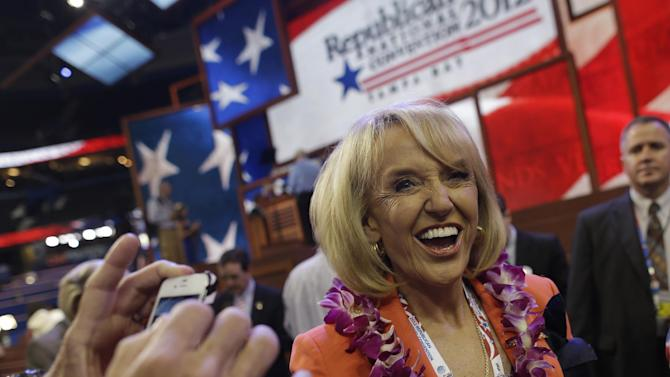 Arizona Gov. Jan Brewer arrives on the floor at the Republican National Convention in Tampa, Fla., on Tuesday, Aug. 28, 2012. (AP Photo/Charles Dharapak)