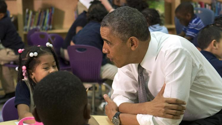 "President Barack Obama greets a pre-Kindergarten class of children at Moravia Park Elementary School in Baltimore, Friday, May 17, 2013, during his second ""Middle Class Jobs and Opportunity Tour"". (AP Photo/Jacquelyn Martin)"