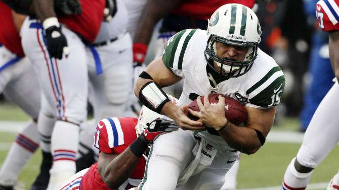 New England Patriots linebacker Jerod Mayo (51) tackles New York Jets quarterback Tim Tebow (15) during the first quarter of an NFL football game in Foxborough, Mass., Sunday, Oct. 21, 2012. (AP Photo/Charles Krupa)