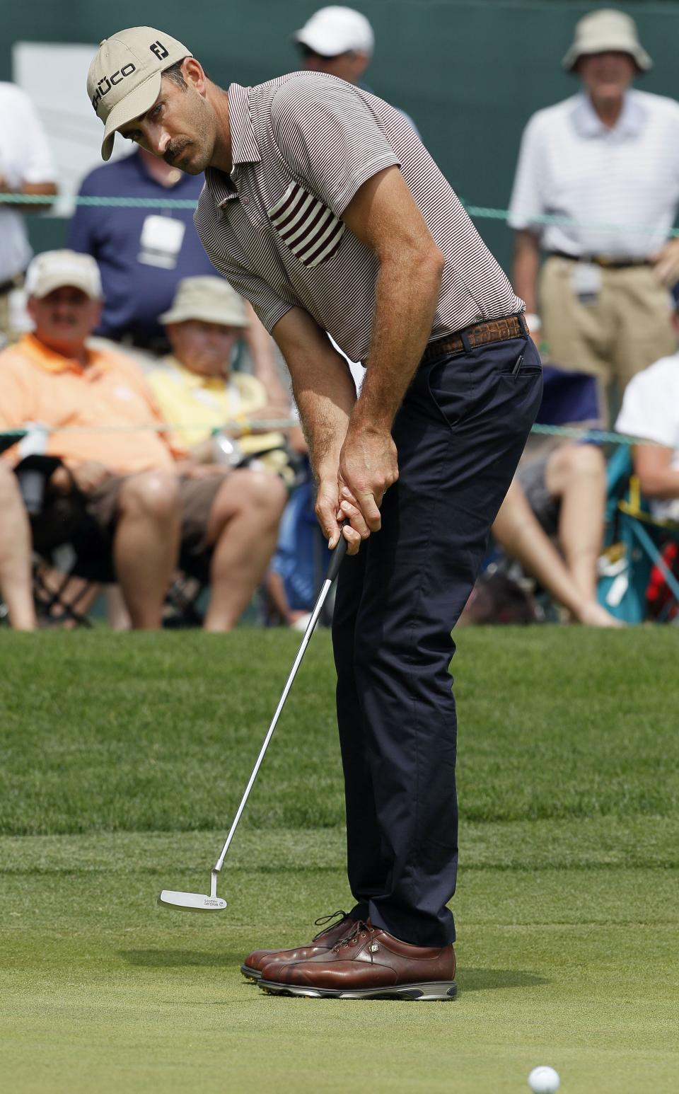 Geoff Ogilvy, of Australia, putts on the 18th green during the third round of the Wells Fargo Championship golf tournament at Quail Hollow Club in Charlotte, N.C., Saturday, May 5, 2012. (AP Photo/Gerry Broome)
