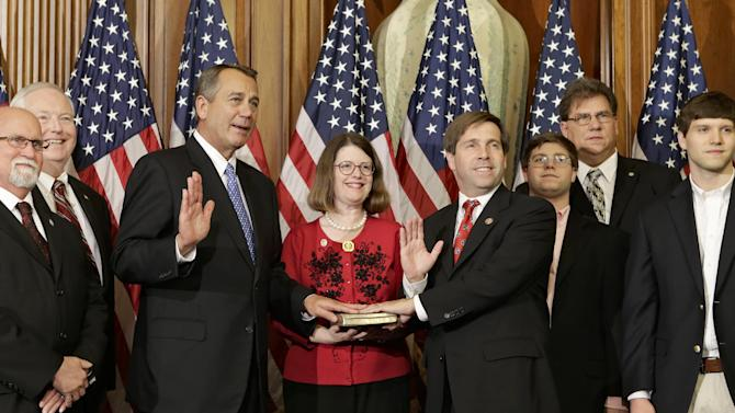 House Speaker John Boehner of Ohio performs a mock swearing in for Rep. Chuck Fleischmann, R-Tenn., Thursday, Jan. 3, 2013, on Capitol Hill in Washington as the 113th Congress began. Rep. (AP Photo/J. Scott Applewhite)