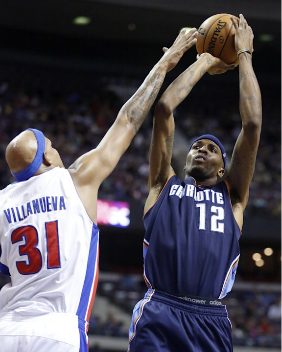 Charlotte Bobcats forward Tyrus Thomas (12) takes a shot against Detroit Pistons forward Charlie Villanueva (31) in the first half of an NBA basketball game, Sunday, Jan. 6, 2013, in Auburn Hills, Mic