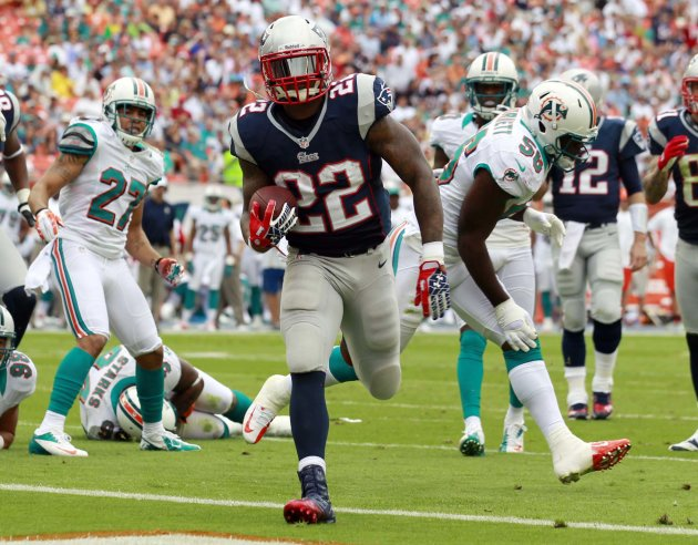 New England Patriots running back Stevan Ridley (22) scores a touchdown during the first half of an NFL football game against the Miami Dolphins, Sunday, Dec. 2, 2012 in Miami . (AP Photo/John Bazemor