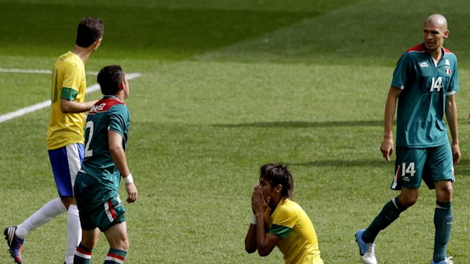 Brazil's Neymar (11) reacts as Mexico's Jorge Enriquez (14) watches during the men's soccer final at the 2012 Summer Olympics, Saturday, Aug. 11, 2012, in London. (AP Photo/Andrew Medichini)