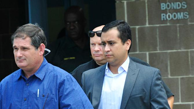 George Zimmerman (R) leaves Seminole County Jail after posting a million dollar bond July 6, 2012 in Sanford, Florida. Zimmerman was charged with second degree murder in the shooting death of Trayvon Martin. (Photo by Roberto Gonzalez/Getty Images)