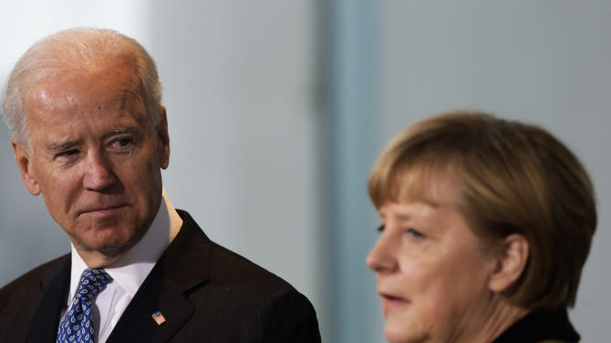 German Chancellor Angela Merkel, right, and United States' Vice President Joe Biden brief the media prior to a meeting at the chancellery in Berlin, Germany, Friday, Feb. 1, 2013. (AP Photo/Markus Schreiber)
