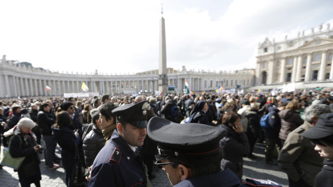 FILE -- In this file photo taken on Feb. 24, 2013, policeman patrol as faithful gather the last Angelus noon prayer of Pope Benedict XVI, celebrated from the window of his studio overlooking St. Peter's square at the Vatican. Planning for the moment when the next pope is proclaimed to the world, and for the installation ceremony a few days later, is a big-time guessing game. And that adds up to an ungodly logistical headache for the city of Rome. Nearly everything went smoothly for Benedict's last public appearances, although some faithful panicked during the retired pope's penultimate Sunday blessing from his studio window, when thousands of last-minute arrivals tried to squeeze through three narrow openings through a metal fence ringing the edge of the square. (AP Photo/Alessandra Tarantino)