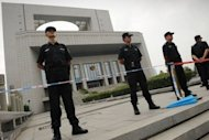 Policemen stand guard outside the Intermediate People's Court in Hefei, Anhui province. China appears to be preparing the public for sparing from execution the wife of politician Bo Xilai who is accused of murdering a British man, a legal expert said Sunday, as a verdict is awaited in the politically-charged case