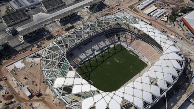 Work resumes at World Cup stadium in Brazil