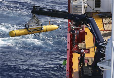 The Bluefin-21 Autonomous Underwater Vehicle is craned over the side of the Australian Defence Vessel Ocean Shield in the southern Indian Ocean during the continuing search for the missing Malaysian Airlines flight MH370
