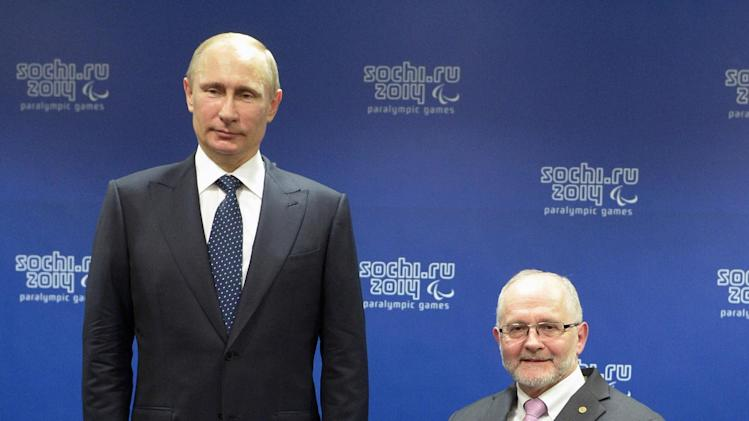 Russian President Vladimir Putin, left, and International Paralympic Committee President Philip Craven pose at a meeting with International Paralympic Committee board members and honorary council members before the opening ceremony of the 2014 Winter Paralympics in Sochi, Russia, Friday, March 7, 2014. (AP Photo/RIA-Novosti, Alexei Nikolsky, Presidential Press Service)