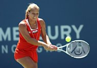 Second seed Dominika Cibulkova beat the heat to reach the final of the WTA hardcourt tournament, the Mercury Insurance Open Presented By Tri-City Medical at La Costa Resort & Spa, outlasting tiring Russian Nadia Petrova 7-6 (10/8), 6-1, on July 21