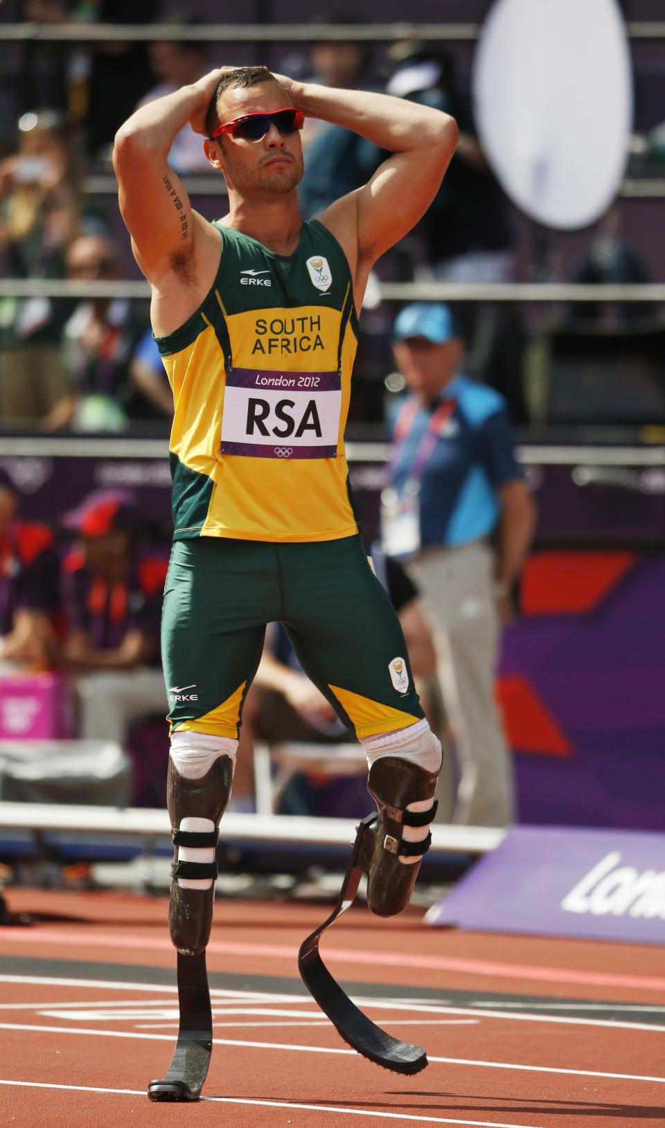 South Africa's Oscar Pistorius reacts after fellow team members crashed out of a men's 4x400-meter relay heat during the athletics in the Olympic Stadium at the 2012 Summer Olympics, London, Thursday, Aug. 9, 2012. (AP Photo/Matt Dunham)