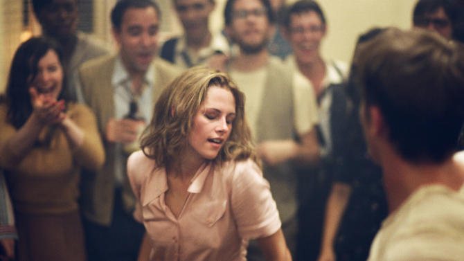 """This undated publicity film image released by IFC Films/Sundance Selects shows Kristen Stewart, center, as Marylou/LuAnne Henderson in a scene from the film, """"On the Road,"""" directed by Walter Salles. (AP Photo/IFC Films/Sundance Selects, Gregory Smith)"""