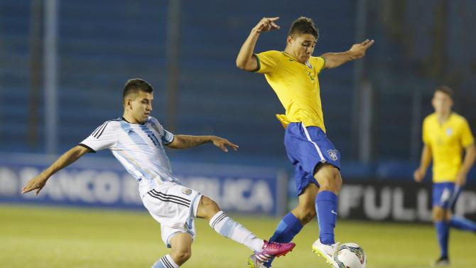 Argentina's Angel Correa and Brazil Joao Pedro competes for the ball during their match for the final round of the South American Under-20 Championship in Montevideo