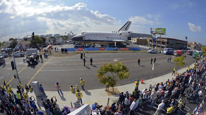 Spectators gather to watch the space shuttle Endeavour in Los Angeles, Friday, Oct. 12, 2012. Endeavour's 12-mile road trip kicked off shortly before midnight Thursday as it moved from its Los Angeles International Airport hangar en route to the California Science Center, its ultimate destination, said Benjamin Scheier of the center. (AP Photo/Mark J. Terrill)